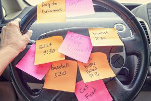 Steering wheel covered in notes as a reminder of errands to do