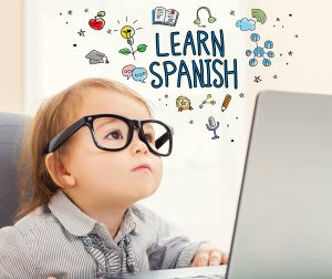 Learn Spanish concept with toddler girl