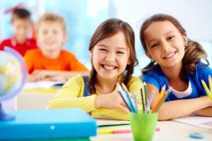 two little girls learning at St. Cecelia Interparochial Catholic School