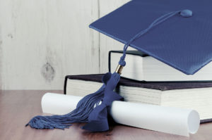 Blue graduation hat on top of books