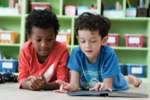 Two elementary boys looking at a book
