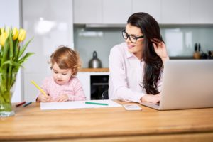 Mother helping child with their homework