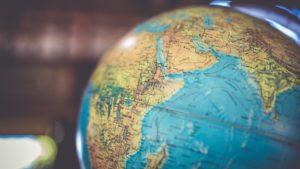 A globe sits on a desk.