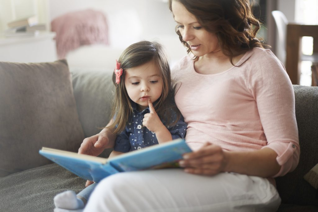 Mother reading to young toddler