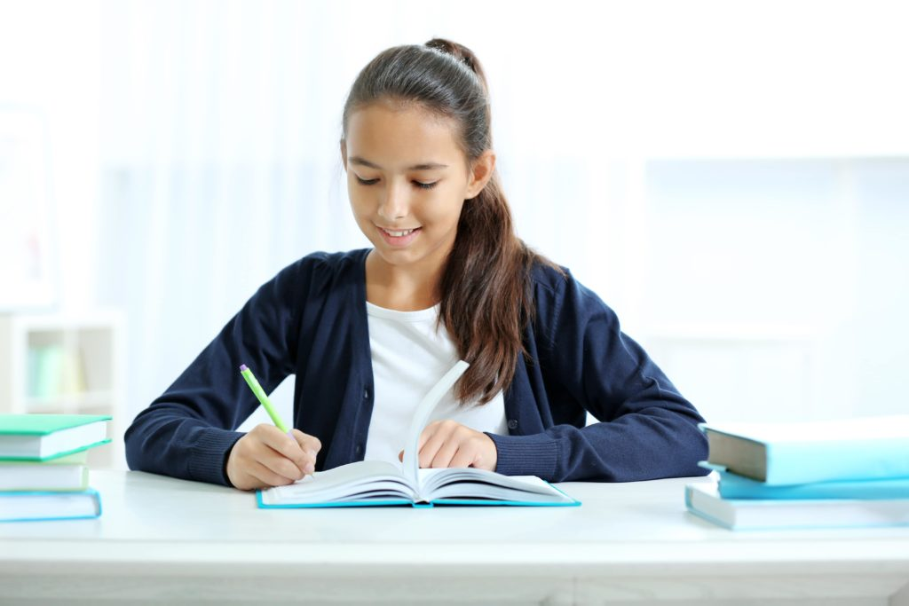 Girl working on homework at desk