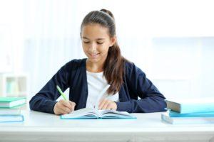 Girl working on homework at desk