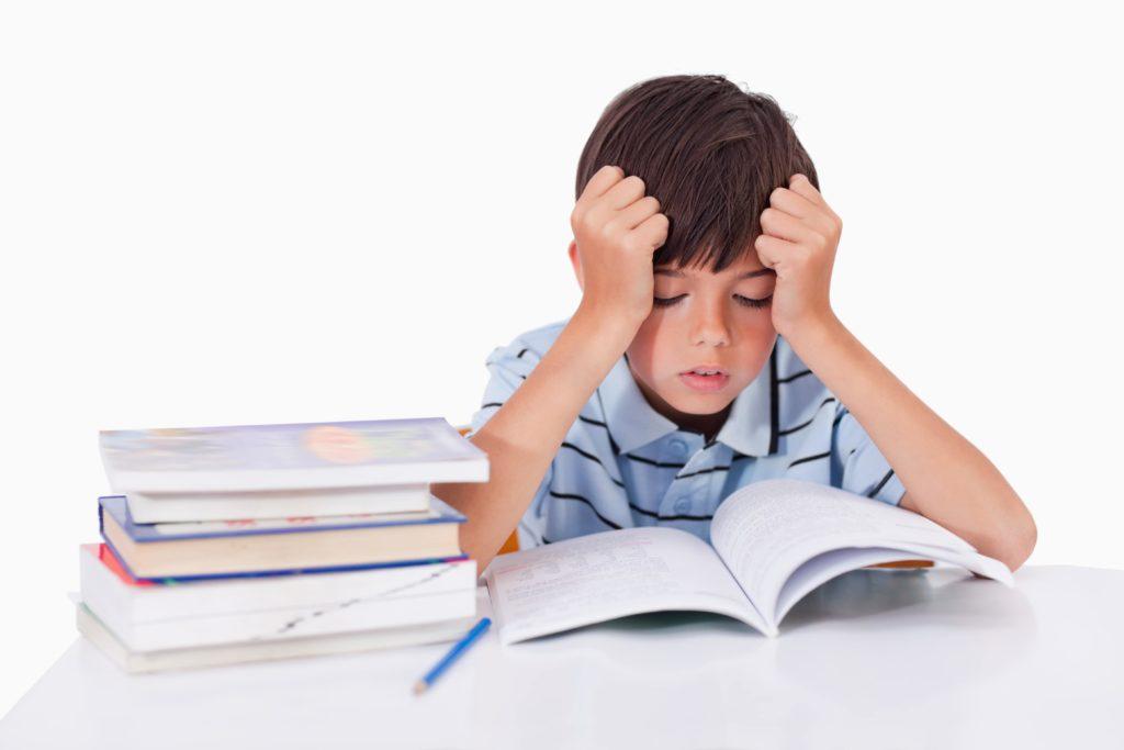 Little boy struggling with school work