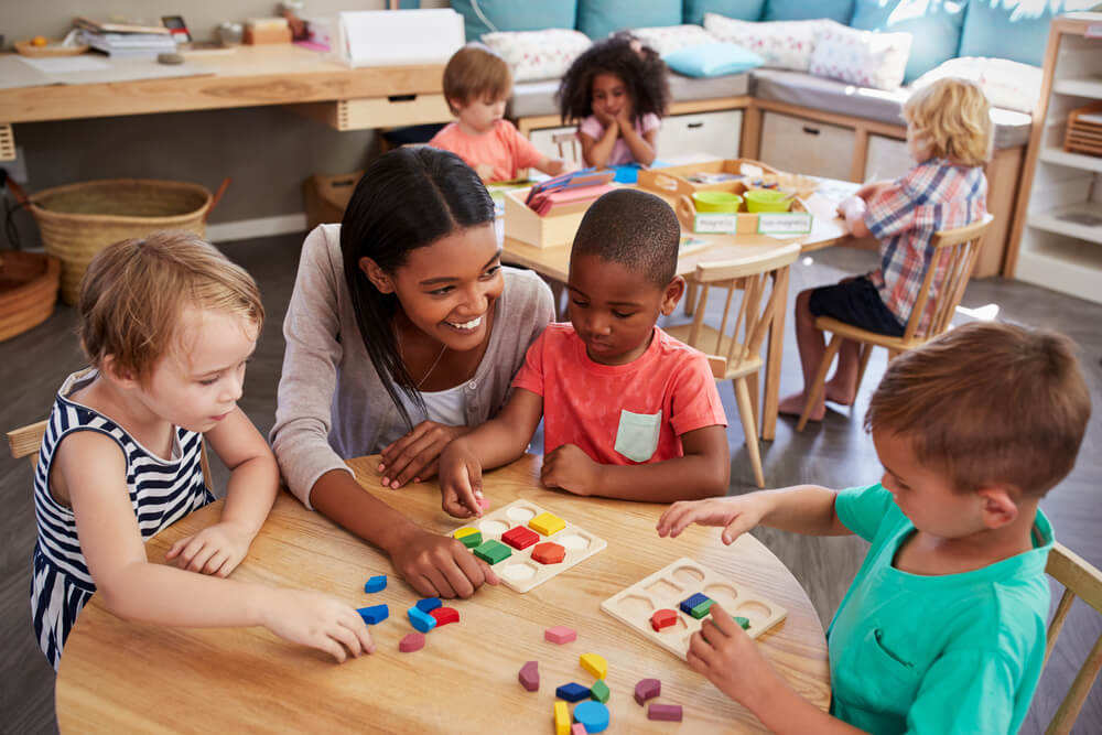 Teacher working with preschool students in the classroom