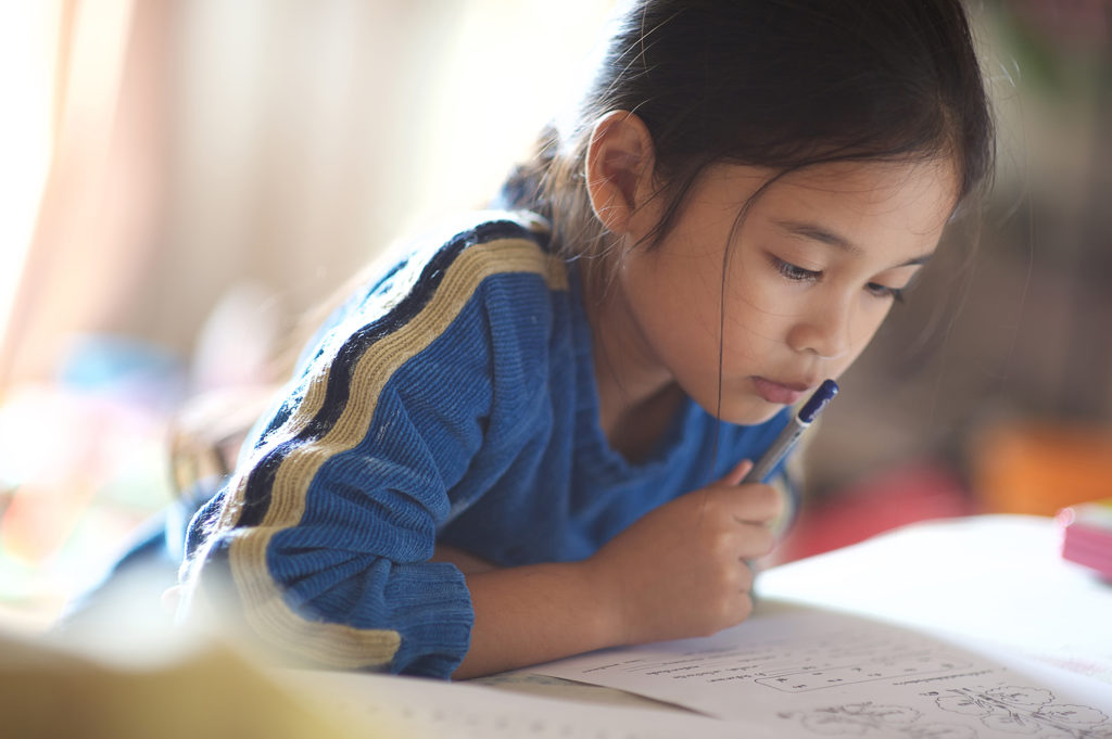 Young girl learning to read