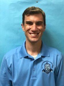 Headshot of M Giles, teacher