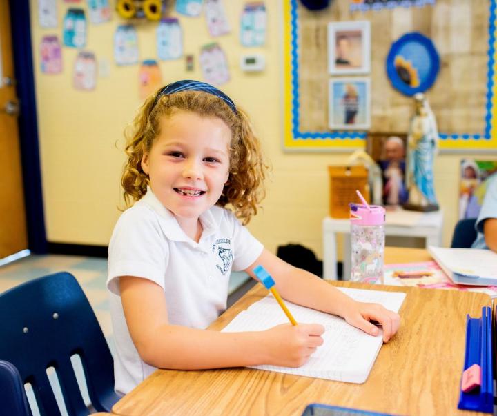 Elementary school girl sitting at desk