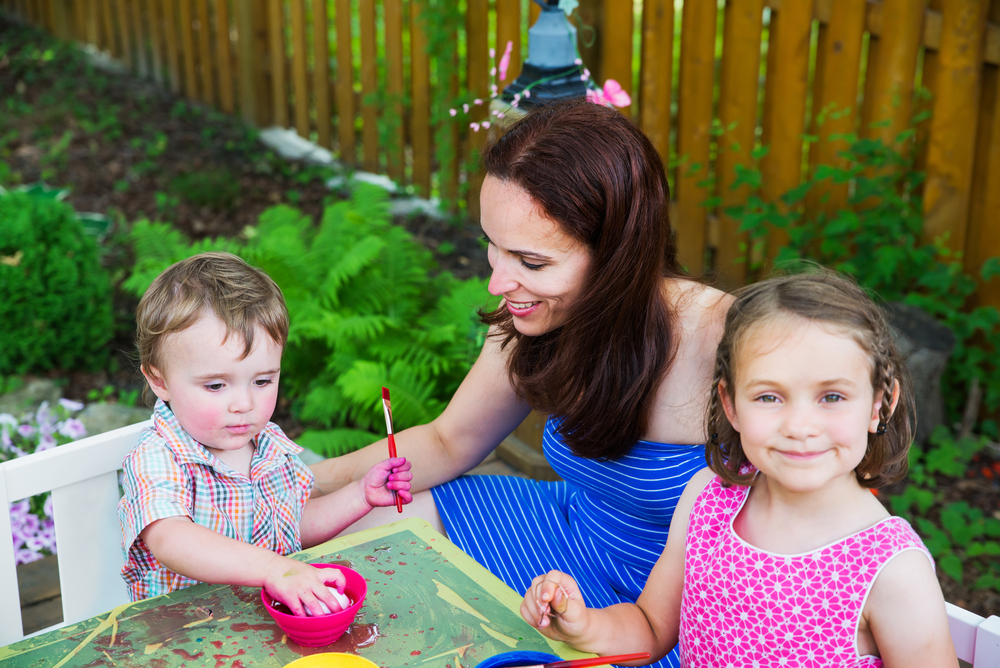 Mom and Kids Coloring Easter Eggs