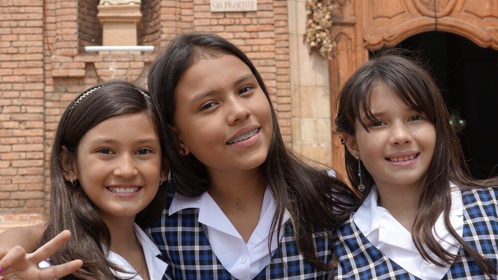 Young girls in school uniforms